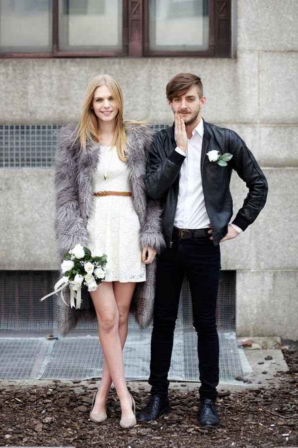 Love this edgy rocker bride's fur vest for her fall wedding look | http://www.weddingpartyapp.com/blog/2014/09/18/6-awesome-coverups-for-fall-brides-stay-stylish-warm/