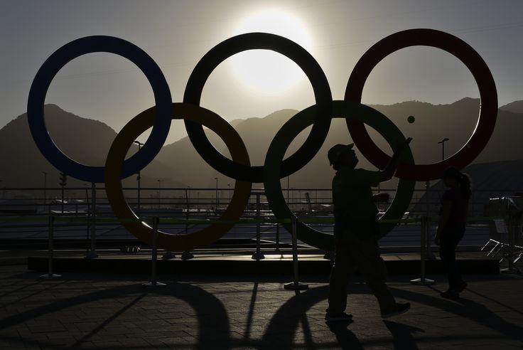 Rio Olympics - Rio de Janeiro, Brazil - 13/08/2016. A man catches a tennis ball…