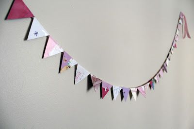 Garland made from old greeting cards. Also a great cutting activity for kids.