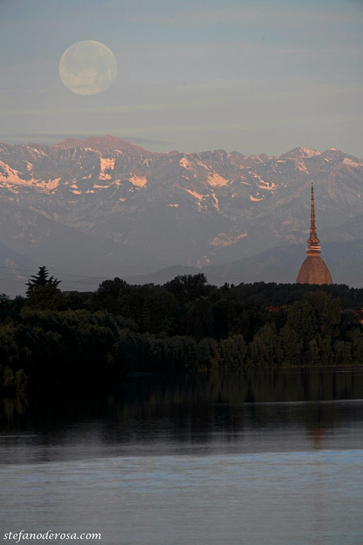 Moon behind the alps and the mole and Mole. Turin