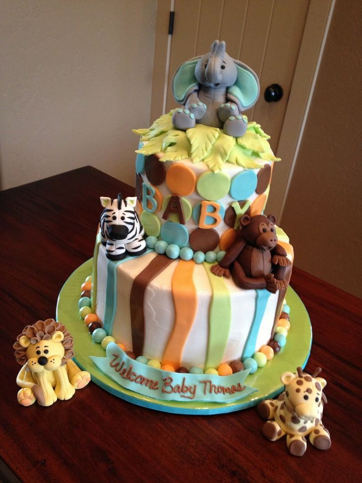 44 best images about baby shower jungle safari cakes for Animal cake decoration