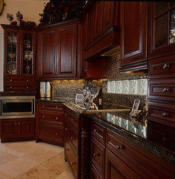 Cherry wood cabinets and dark granite tops