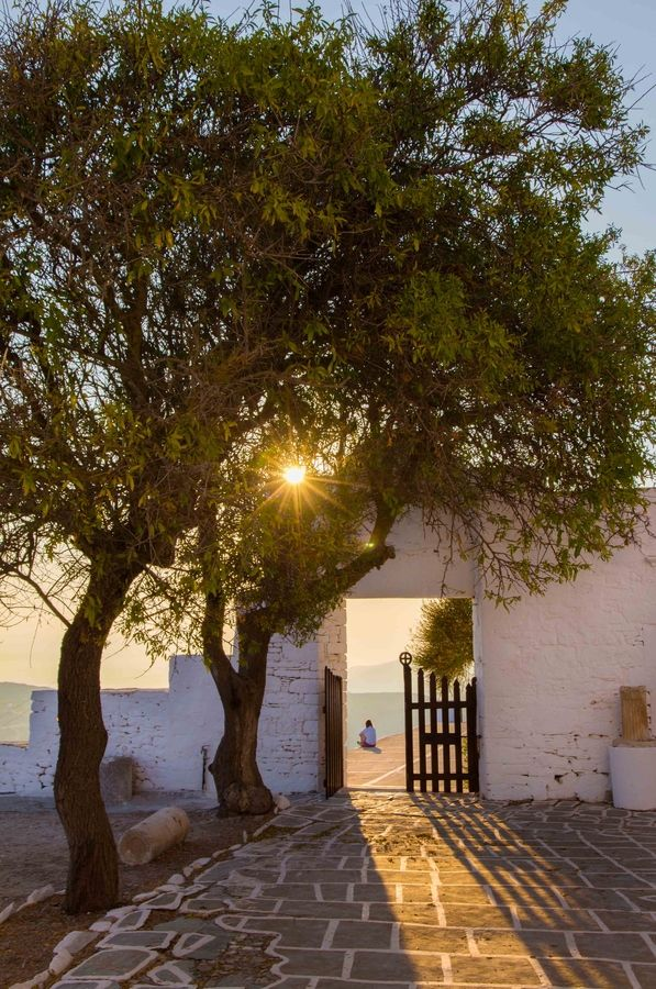 View of the gate of Panagia church dominating Chora village in Amorgos. ...