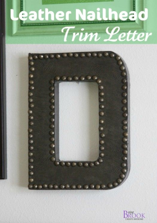 Leather nailhead trimmed letter