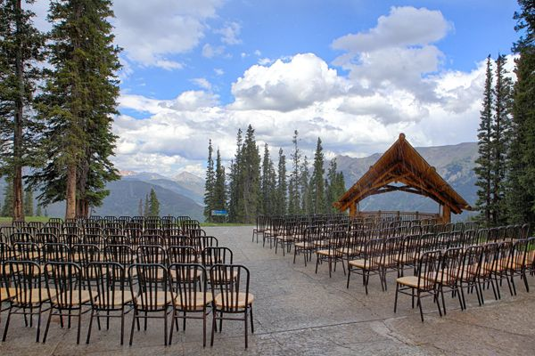 """A Ski Nut's Nuptials at Copper Mountain Resort in Frisco, Colorado: Drive in, drive out? Pffft. How about ski-in, ski-out? Tie the knot at over 11,000 feet, and then ski down the mountain with your wedding party at Copper Mountain Resort, where you can choose to make your """"reception"""" a post-ceremony chairlift ride and ski with your wedding party and guests. If you prefer, you can skip the sweaty, sporty action while still getting married atop the actual mountain at Solitude Station, peering…"""