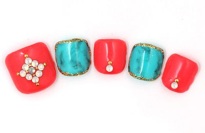 Coral and turquoise toe nails with golden glitter and rhinestones.