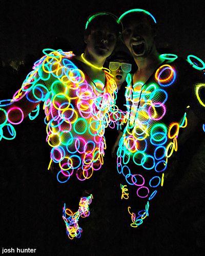 Glow Bracelets ALL over! Looks like neon polka dots. Great last-minute Burning Man costume + pretty inexpensive: http://www.flashingblinkylights.com/assorted8inchglowbracelets-p-1749.html
