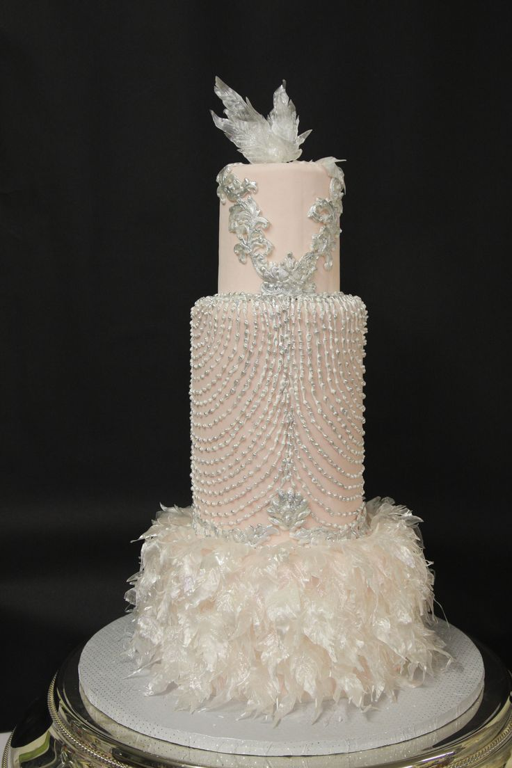Art Deco wedding cake designed from a wedding dress.  Pulled sugar feathers. - pulled sugar feathers