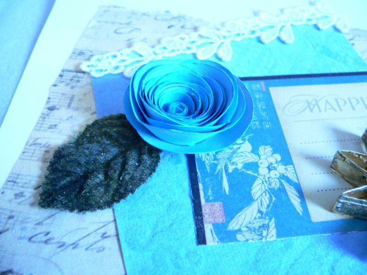 This is a paper Rose that I rolled on The Pendant Roller. The Pendant Roller is pictured on this page. Barbara Del Duco