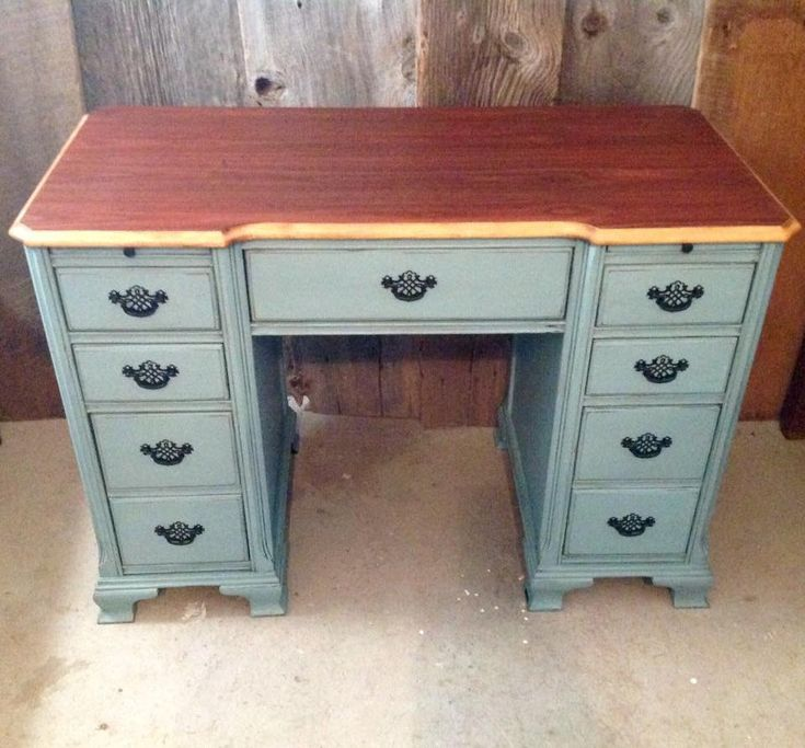 Antique desk finished in Heirloom by Fusion Mineral Paint ,distressed and dark waxed . Top is finished with hemp oil.