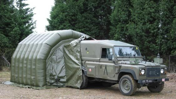 Command Inflatable Tents : Military vehicle connected to temporary inflatable