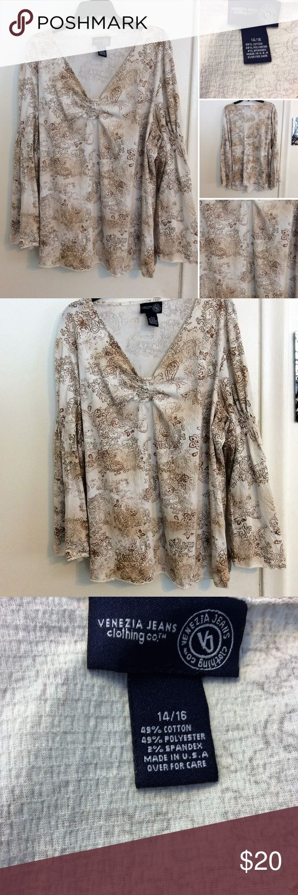 venezia jeans plus size top this Venezia Jeans plus size top is in excellent new like condition. It has very neutral colors with a pretty pattern print to it. This is a size 14/16 and is a cotton blend Venezia Tops