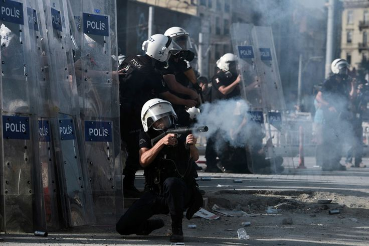 Turkish riot police fire tear gas at demonstrators in Taksim Square, on June 11, 2013