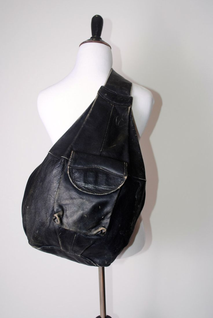 Vintage 1990s oversize extra large huge BLACK soft distressed LEATHER one shoulder BACKPACK rucksack by BushwickCouture on Etsy https://www.etsy.com/listing/217501297/vintage-1990s-oversize-extra-large-huge