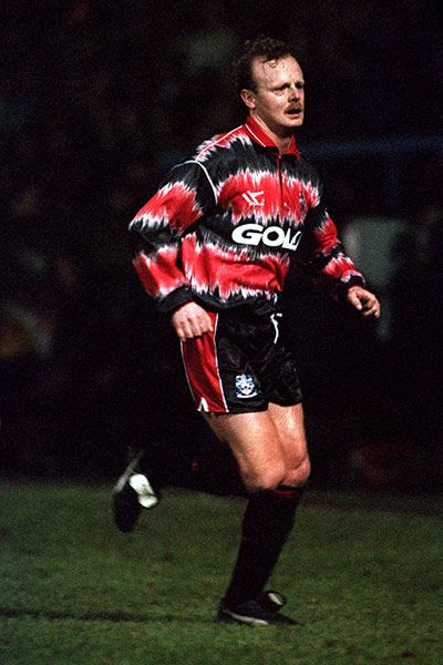 """Credit: Neal Simpson/EMPICS Sport Huddersfield Town went all tie-dye in the 1991-92 season. <a href=""""http://www.football-shirts.co.uk/fans/worst-football-kits-in-history-huddersfield-town-199394-away-goalkeeper-shirt_18955"""">Their away goalkeeper jersey</a> of 1993-94 was pretty vile too"""