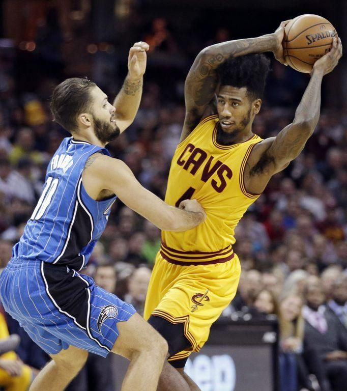 The Cavaliers' Iman Shumpert looks to pass over Orlando Magic's Evan Fournier during the first half of Saturday's game in Cleveland. The Cavaliers won 104-79.