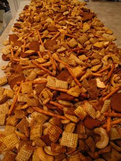 Here's one of my favorite munchie recipes. It's basicallya traditional chex mix from chex.com with a few tweaks. It was requested that, along with my hubby and I, we bring a batch of this chex mix to our little family reunion in Montana! I have had people asking for me to re-post this, so here…