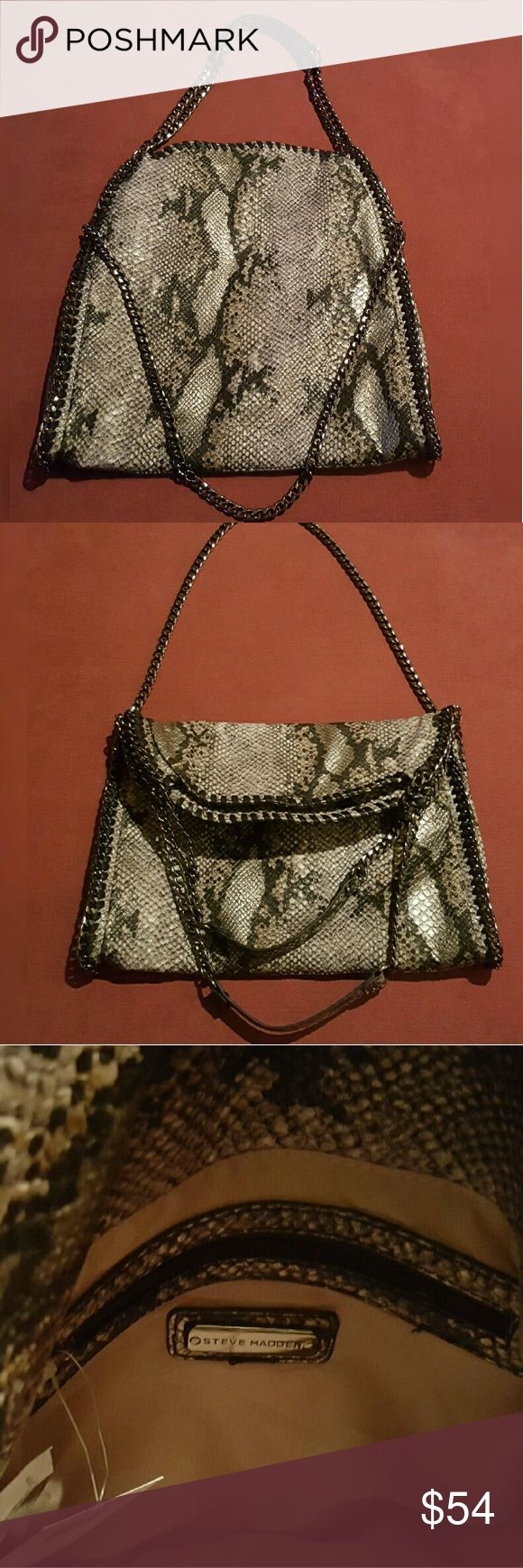NWT Steve Madden Fold-Over Tote Looks like the highly sought after Stella McCartney Falabella, but it isn't. It also happens to be vegan. Three chains. Faux reptile. Lots of room inside. One large interior pocket with zip and two open pockets to stow away your devices. Get the high end look without the high end price. Very chic! Please be considerate and take into account the asking prices of your own sale items prior to negotiating a deal. Only reasonable offers considered.  No trades…