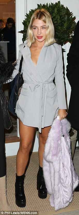 Black and white delight: Kimberly Wyatt sported a furry jacket and long black skirt while Jess Woodley sported a grey mini dress