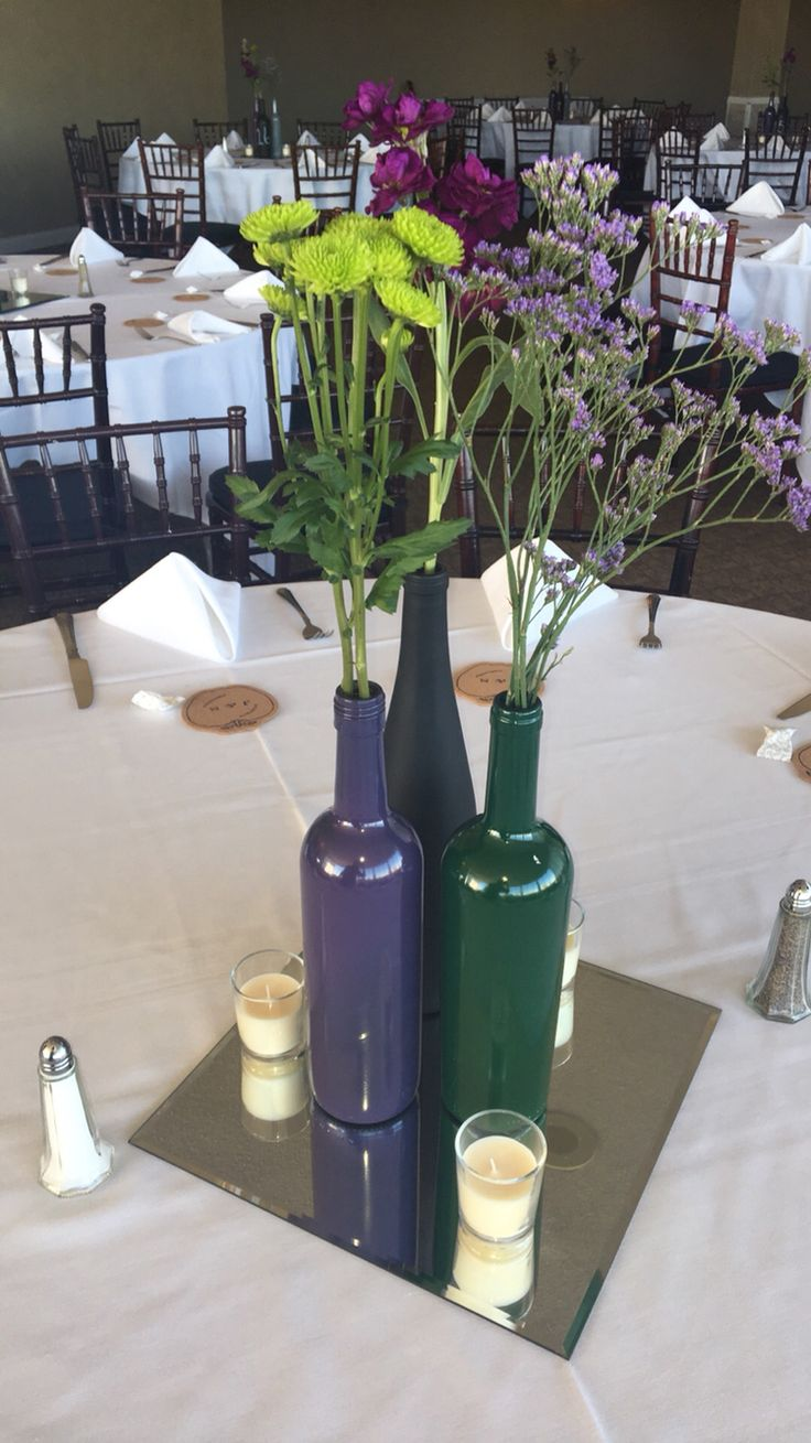 Wine Bottles With Flowers For Centerpiece