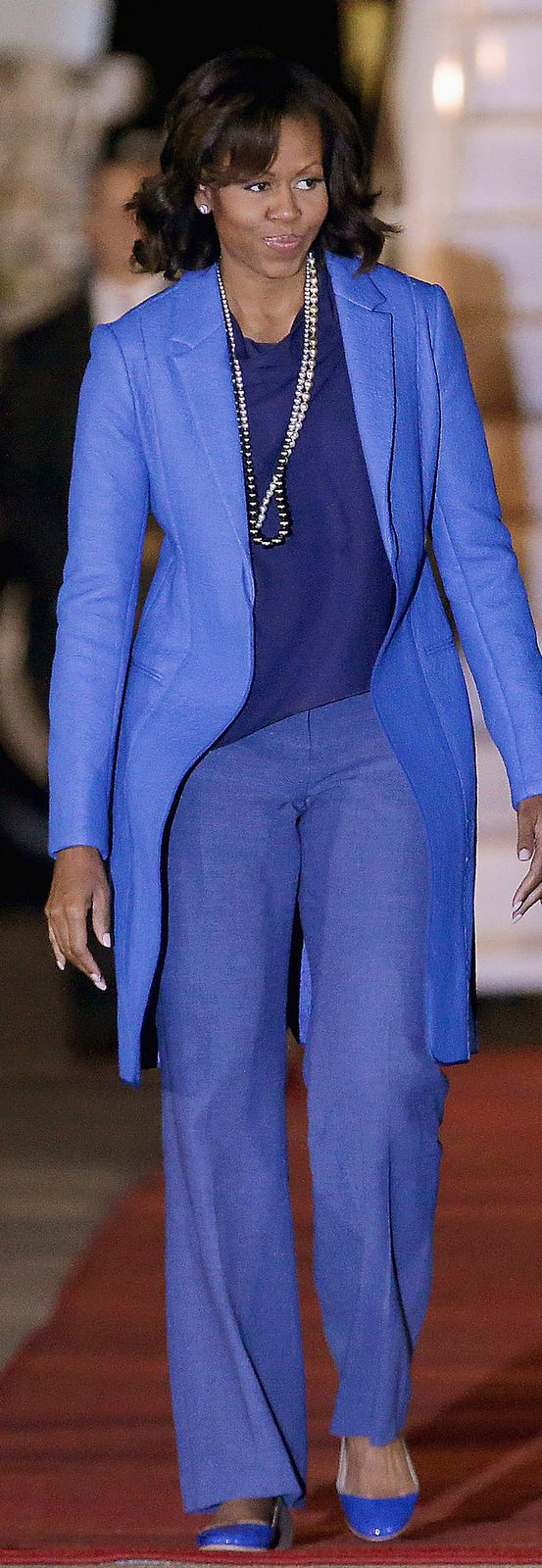 Michelle Obama - often wears coloured shoes which is unusual but fabulous.