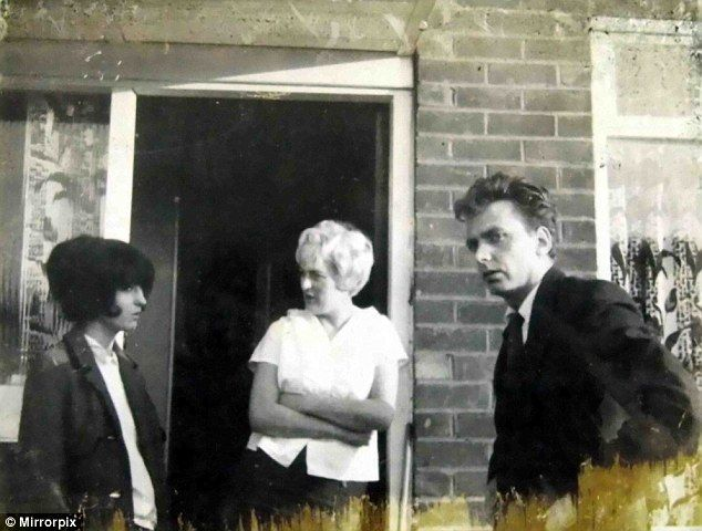 This photo from 1965 shows Moors murderers Ian Brady and Myra Hindley (middle) with her sister Maureen. Shortly before it was taken at least one young child was tortured and brutally murdered in the house behind