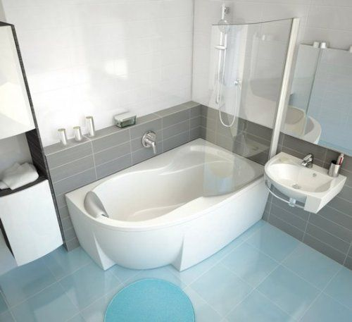 White Bathtub with Shower Above It in Small Bathroom Design