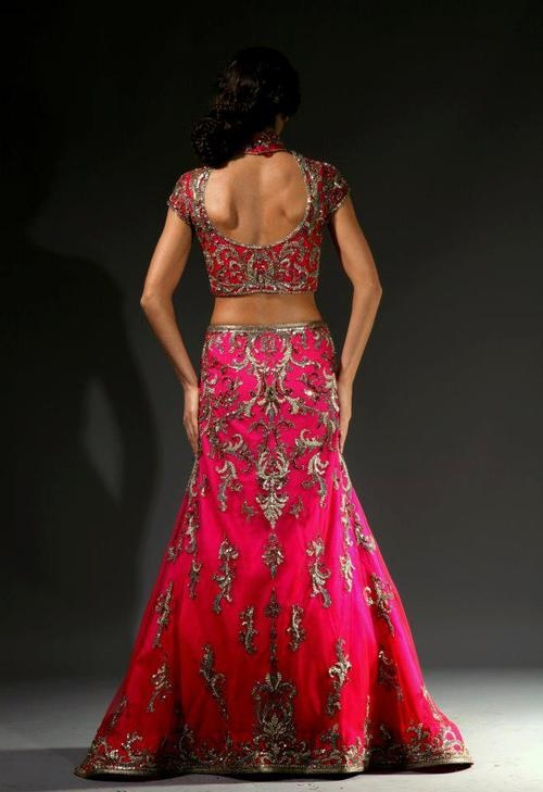 Pink lehenga.  With gold embroidery.   South Asian bride