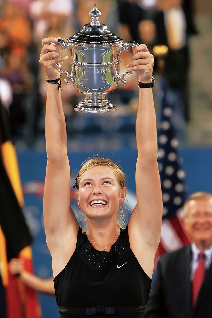 Nothing but aces. Maria Sharapova holding her 2006 US Open Trophy.