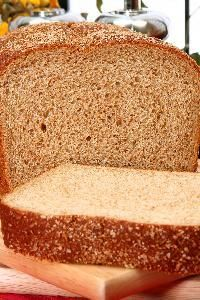 Wheat grain has been a valuable food for thousands of years. Whole wheat bread packs the nutrition of all three components of the wheat kernel. The outer rough layer of the grain -- the bran -- is valuable for its fiber; the wheat germ of the seed is high in nutrients; and the majority of the grain, called the endosperm, is a good source of carbohydrates.