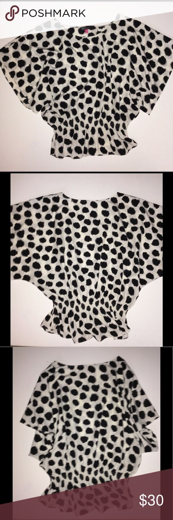 Vince Camuto Medium White & Black Spot Batwing Top This is a white Vince Camuto Top with Black Spots. It is a size Medium. Excellent Condition. It has a rounded neck, batwing sleeves, and a tapered Peplum style waist. This would be a fantastic casual or dressy top for fall. Keywords: designer, batwing, short sleeve, draped, Peplum, Polka Dot, polkadot, polka-dot, 3/4 sleeve, work, career, job interview, Blouse, shirt Vince Camuto Tops Blouses