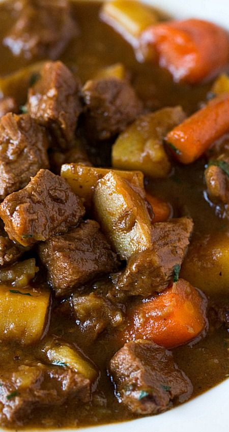 Guinness Beef Stew ~ This is the BEST beef stew ever...  Incredibly tender meat, potatoes and carrots, all swimming in a perfectly smooth and rich Guinness-spiked sauce. Absolutely delicious!