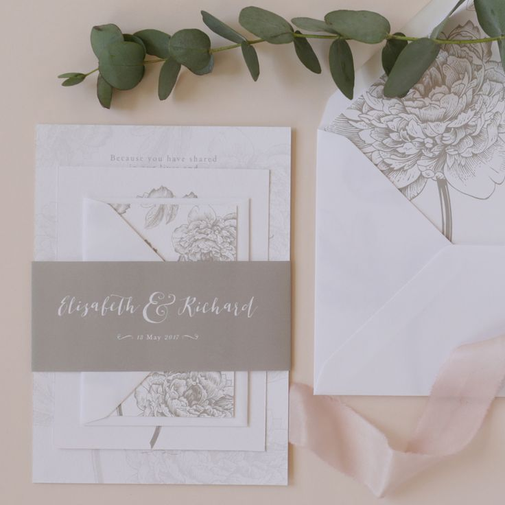 A classic and romantic wedding invitation suite featuring detailed floral illustrations paired with calligraphy inspired fonts. classic wedding stationery, romantic wedding stationery, eucalyptus wedding stationery, vintage floral wedding stationery, hand dyed silk ribbons, illustrated floral envelope liner