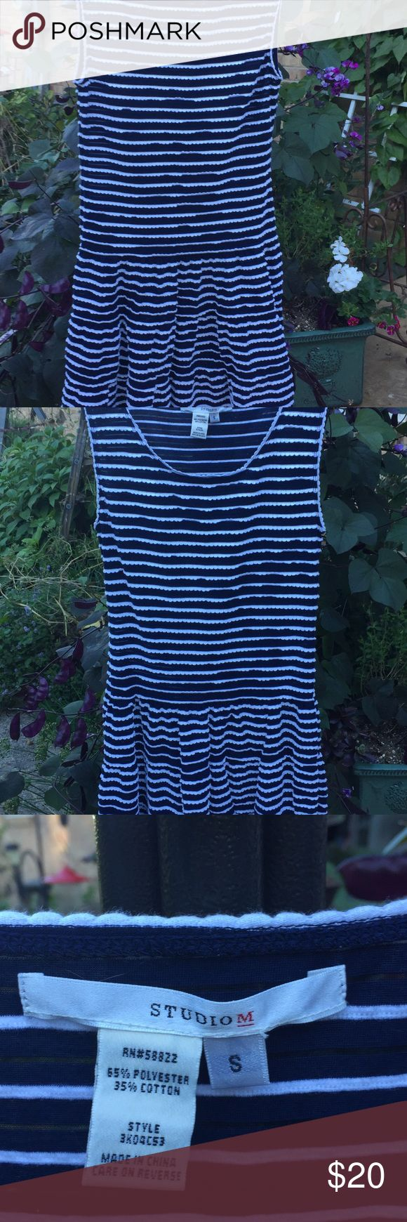 """Navy with White Scalloped Dress Sleeveless Navy with white scallops texture as stripes throughout dress.                                            I know the pictures don't do this dress justice as far as colors go. Dress has drop waist. Two tiered gathering. Length is 37/12"""" . Used but looks new. 50% polyester and 50% cotton. Machine wash cold and dry flat. As always I line dry. No problems! Lightweight and easy care. Great to pack for any warm weather vaca! studio M Dresses"""