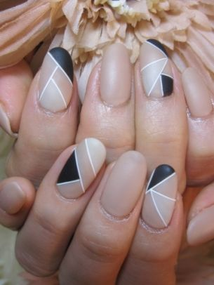 Fun nail design. I would skip the black and do shades of nude with white stripes!