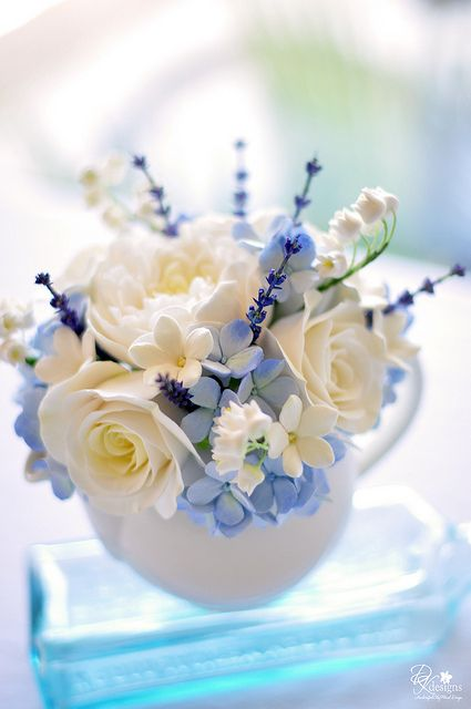 roses, lily of the valley, stephanotis, and forget me not's!