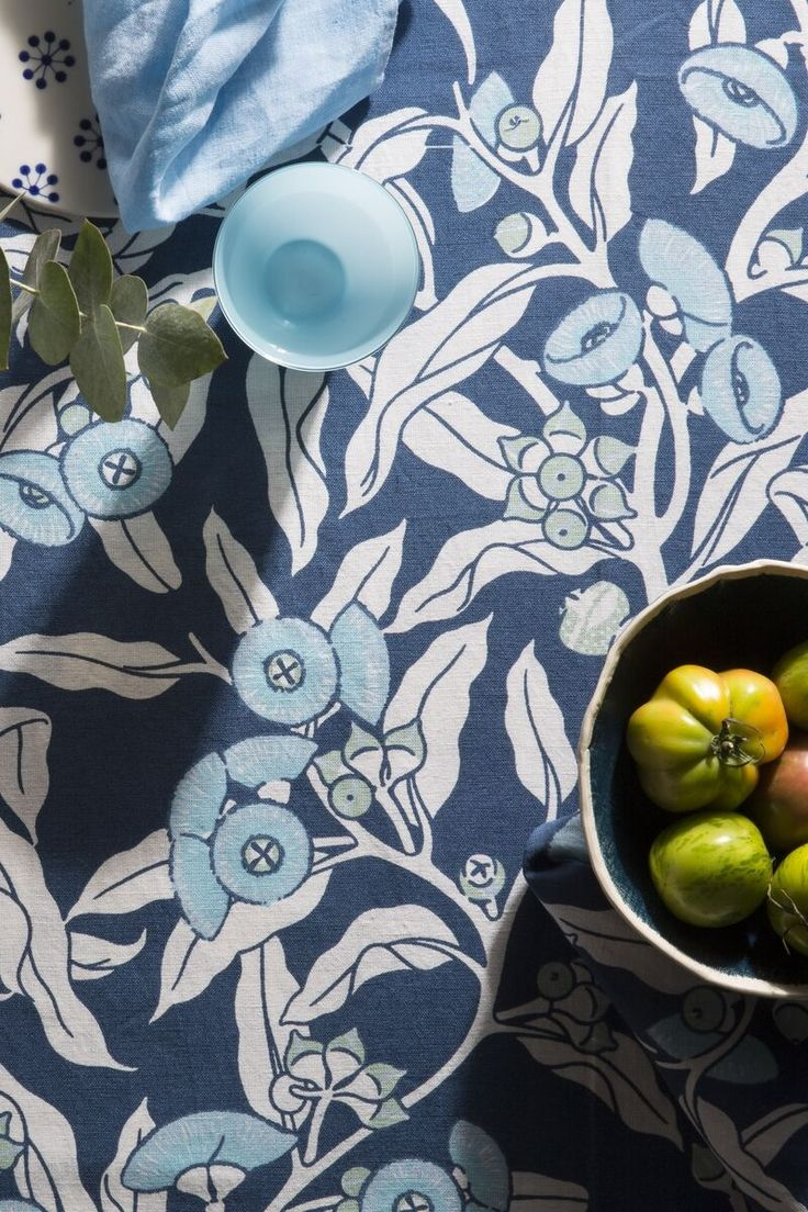 The Mallee Gum - Indigo pattern is reminiscent of the multiple stems that spring from the Mallee root and its fiery show of blooms. The Mallee Gum print is available in a soft dusky pink and grey colour way and in an indigo palette, featuring explosions of pale blue flowering gums on indigo. Hand illustrated, screen printed and limited edition.  www.utopiagoods.com
