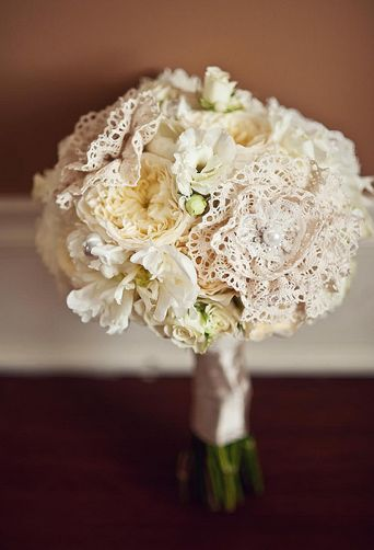 I'm not usually a fan of fake flowers, but I do really like the lace flowers incorporated with the real.