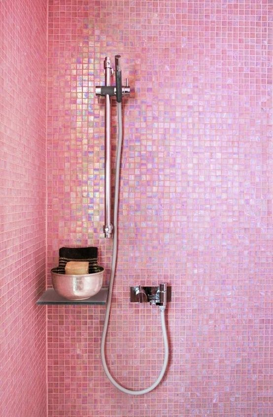 Pearlescent pink glass mosaic tile in the shower.  I would so do this if I could have my own master bathroom!