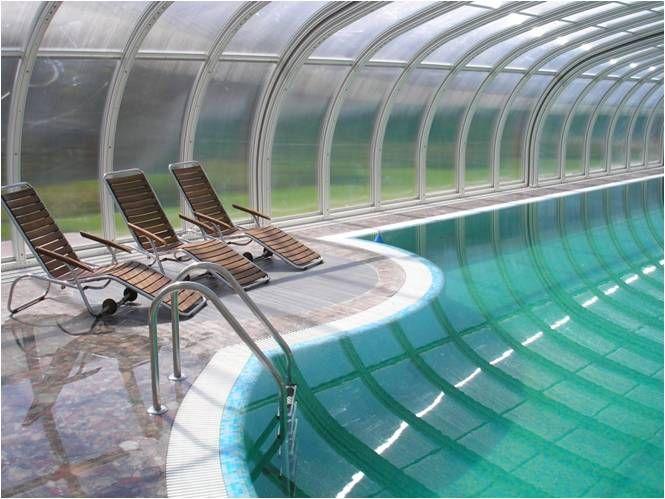 Переливной бассейн в загородном доме. Стационарный павильон для бассейна  «Royal»Vöroka — с максимальной возможностью комфортной эксплуатации.