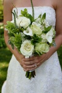Green roses.  White roses. White calla lily. Bells of Ireland.  Green millet.