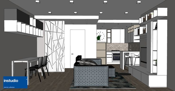A careful space distribution has transformed this small apartment into a comfortable open space. Interiors with contemporary furniture that are well suited to everyday life. Note the wall covering inspired by the vintage lines of traditional cement tiles.