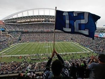 A Fan waves a 12th Man Flag at CenturyLink Field Picture at Seattle Seahawks Photo Store