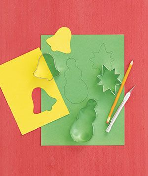 Use cookie cutters and repurpose old holiday cards to create your own gift tags.