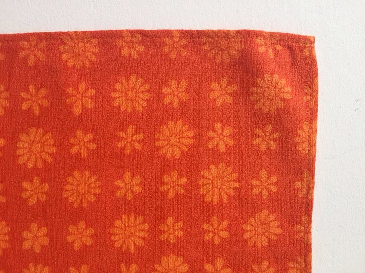 Vintage orange placemats with retro print of daisies, linen 1960's table mats, daisy print 1960's placemat set by GoodsGarb on Etsy