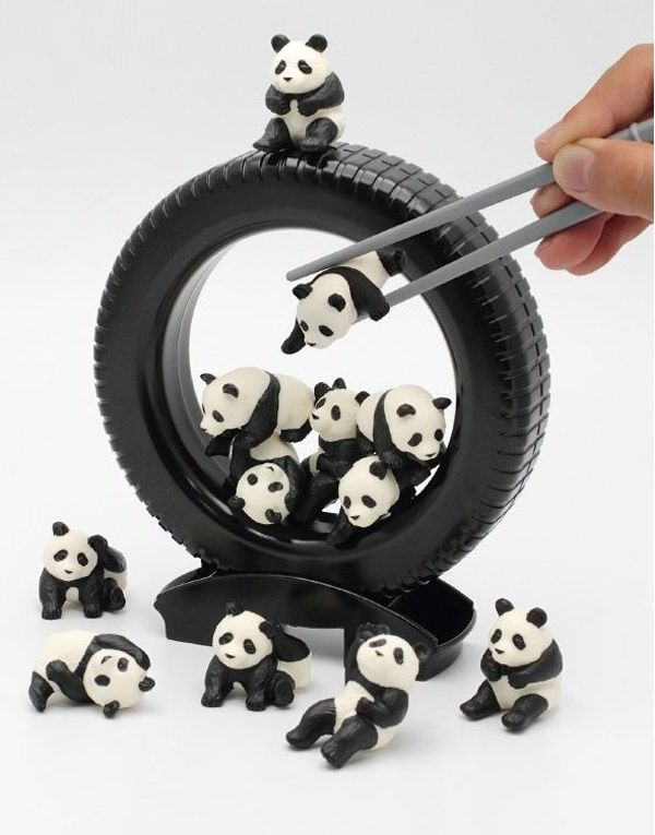 Panda Darake...the goal of the game is to get all 12 pandas into the wheel using chopsticks. It's like...Asian Jenga in reverse.