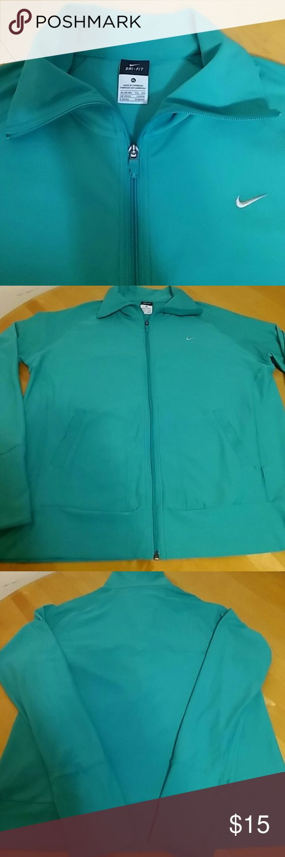 Nike Dri-Fit XL Nike Dri-Fit Jacket for Women's, Size XL, 92% Polyester,  8% Spandex, used gently. Color Turquoise. Nike Jackets & Coats Utility Jackets