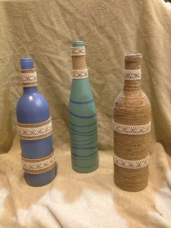 Set of three decorative wine bottles. Wrapped in burlap, twine and lace. Perfect for that empty spot on your shelf or a gift to a friend.