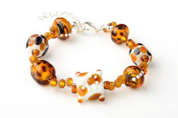 CORALLIA'S exclusive lampwork glass leopard by coralliajewellery