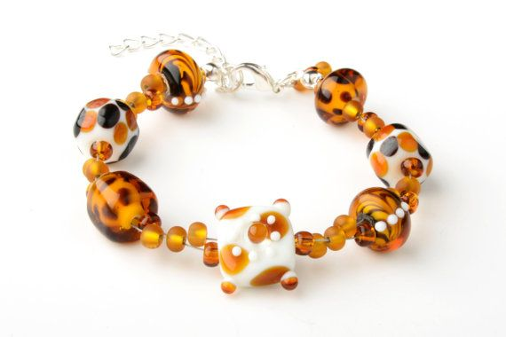 CORALLIA'S exclusive lampwork glass leopard by coralliajewellery